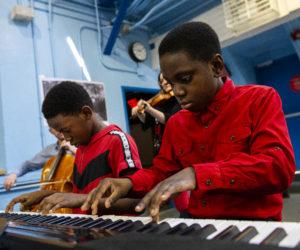 Boys playing piano