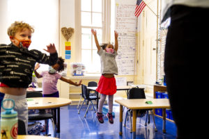 A student jumps during music class.